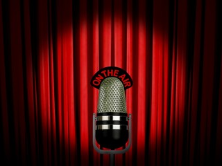 vintage microphone on air over red curtain