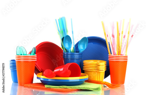Bright plastic tableware and napkins isolated on white