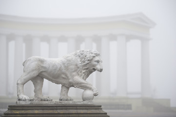 sculpture in the fog on the background of the colonnade
