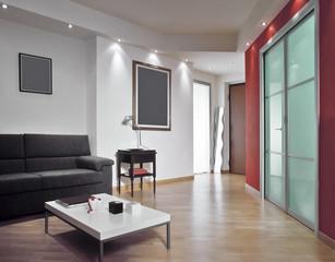 ingresso affacciato su un moderno soggiorno con parquet