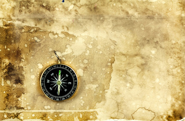 Compass on old vintage grunge paper background