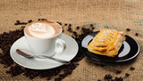 Cappuccino cup with croissant