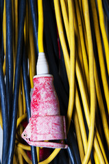 yellow high voltage cable extension with red plug