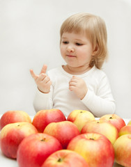 The girl is counting apples.