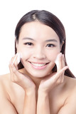 Beautiful woman washing her beauty face with cleansing foam poster