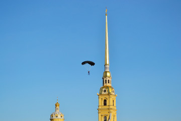The spire of Peter and Paul Fortress and parachutist