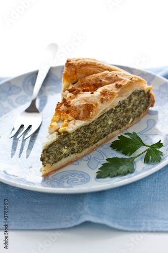 Cake with spinach, herbs and cheese