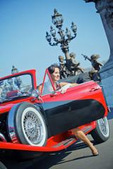 Happy smiling woman in a car. Romantic in Paris.