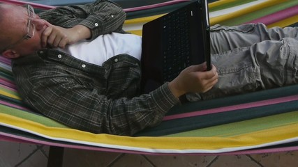 Male - Working with Notebook on Hammock