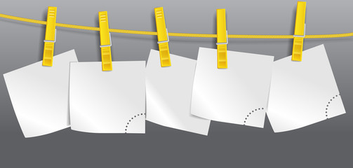 Blank paper sheets on rope