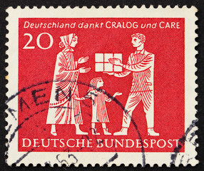 Postage stamp Germany 1963 Mother and Child Receiving Gift Parce