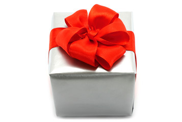 Silver present box with red bow on a white background