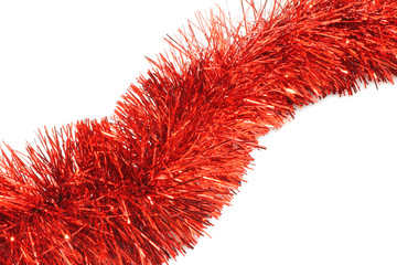 Red tinsel close-up on white background