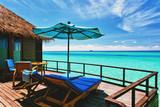 Fototapety Overwater villa balcony overlooking tropical lagoon