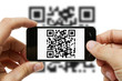 Scanning QR code with mobile phone - 37824221
