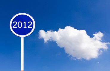 Round sign 2012 on blue sky