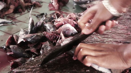 Cutting fishes in Wet Market