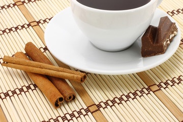 Cup of coffee with chocolate and cinnamon