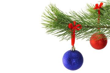 Christmas balls on fir tree branch