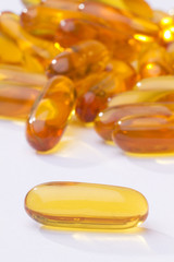 shiny yellow fish oil capsule