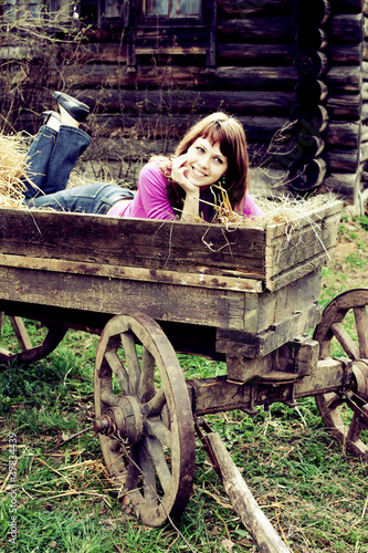 Attractive young woman resting in horse cart
