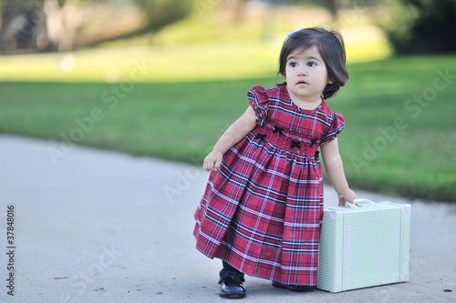 toddler with a suitcase