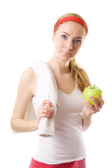 Sporty woman with towel and green apple
