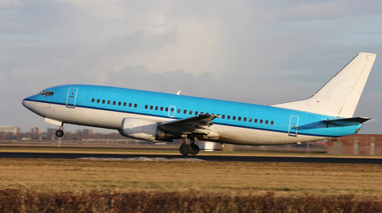 blue plane taking off