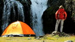 Female Hiker by Tent at Waterfall