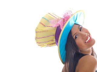 smiling girl wearing a fancy hat