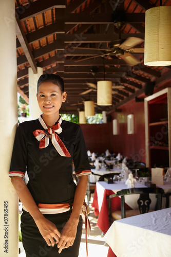portrait of asian waitress working in restaurant