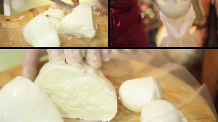 Knife divides fresh mozzarella - Italian food