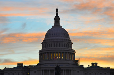 United States Capitol Building silhouette at sunrise