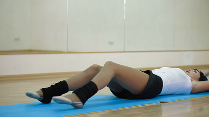 Adult woman doing sit ups
