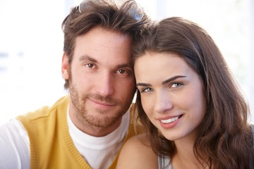 Closeup portrait of attractive couple smiling
