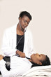 African lady doctor examining patient