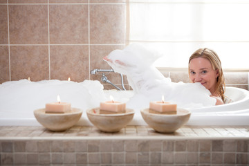Happy mature woman in a spa