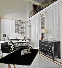 camera da letto classica con tessuti bianchi e neri