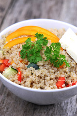 Close up of quinoa salad with veggies and feta