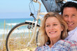 Couple cycle to the sea