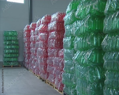 Pile of packed multicolor PET bottles in warehouse