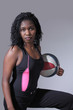 Tough black sportswoman with basketball