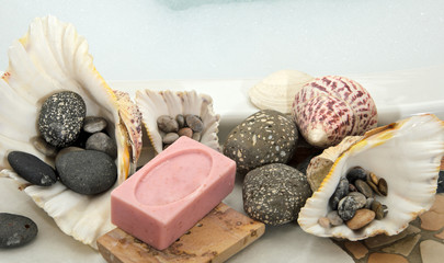 decoration in a bathroom: soap, shells and stones