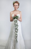 Floristics - bride blond with bouquet of fresh tender flowers