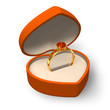 Orange heart-shape box with golden ring with jewels