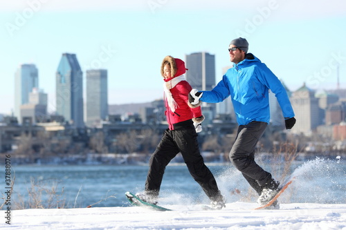 Winter couple fun on snowshoe in Montreal