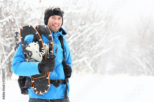 Winter snowshoeing man