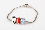 Beads modular bracelet isolated over white poster