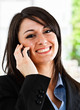 Beautiful smiling woman talking at phone