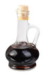 Small decanter with balsamico vinegar  isolated on the  white